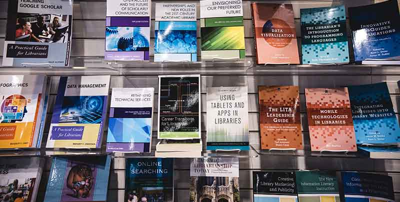 wall of books of library standards and guidelines