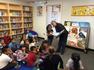 Jean Whitehorse of the Crownpoint Outreach Center delivers storytime to kids as part of summer reading.